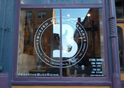 Buzzed Bull Creamery decal on store front