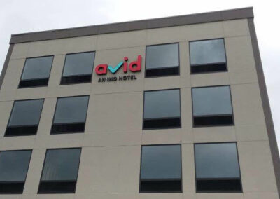 Avid hotel sign on building